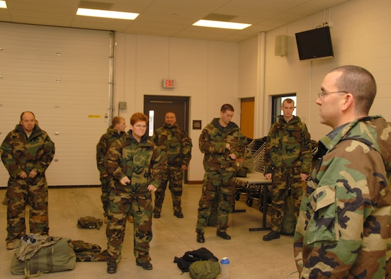 SSgt. Anthony Scuderi is teaching a class about the proper wear of the chemical warefare suit during the Unit Training Assembly on February 7th 2009. Staff Sgt Scuderi is a CBRNE trainer for the 174th Fighter Wing, Syracuse NY.  (U.S. Air Force Photo by Staff Sgt Ricky Best)/ Released