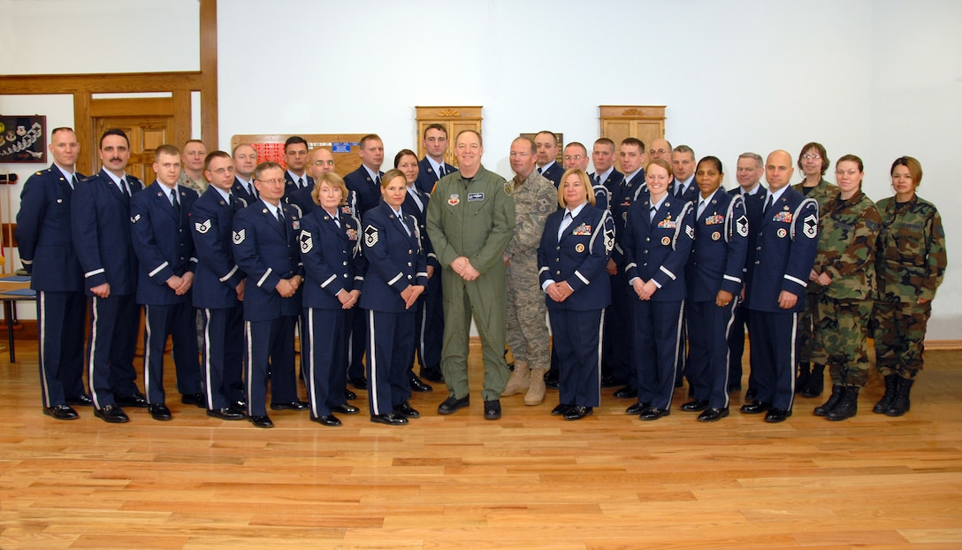 Col. Kevin Bradley and Command CMSgt. David Heckman pose with the Hancock Field Base Honor Guard team following their annual awards ceremony during the February Unit Training Assembly. The Base Honor Guard team which consist of more than 52 members of Hancock Field,who do this voluntarily, participate in many events to include burial honors, retirement ceremonies, parades, etc. throughout the Central New York area and beyond.