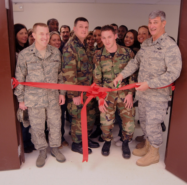 Col. Bill Ketterer, vice wing commander, cuts a ceremonial ribbon at the reopening of the Morale, Welfare and Recreation facility. The facility was shut down for more than a year after a cement truck crashed into the building housing it. (Photo by Senior Airman Max Rechel, Kentucky Air National Guard)