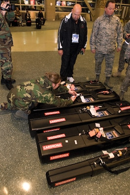 Senior Amn Jennifer Lewis of the Joint Task Force (JTF) Special Olympics, which has been stood up with members of the Idaho National Guard to provide logistical support for the 2009 Special Olympics World Winter Games, help sort equipment baggage of Team New Zealand at the Boise Air Terminal, Idaho on January 30, 2009. (U.S. Air Force photo by Senior Airman Robert Barney / RELEASED)