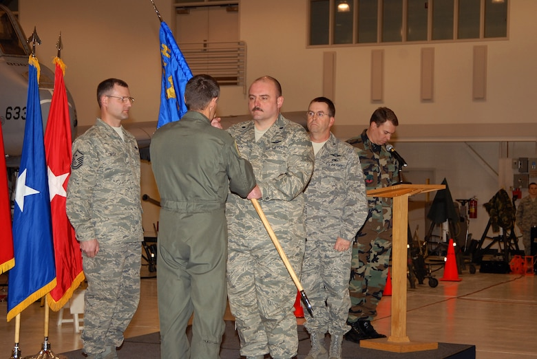 Lt Col Craig Logan receives the 124th Maintenance Squadron's flag from 124th Wing Commander Col James Compton upon assuming command of the 124th Maintenance Squadron after Col Robert Park took command of the 124th Maintenance Group. (Air Force photo by Staff Sgt Heather Walsh) (Released)