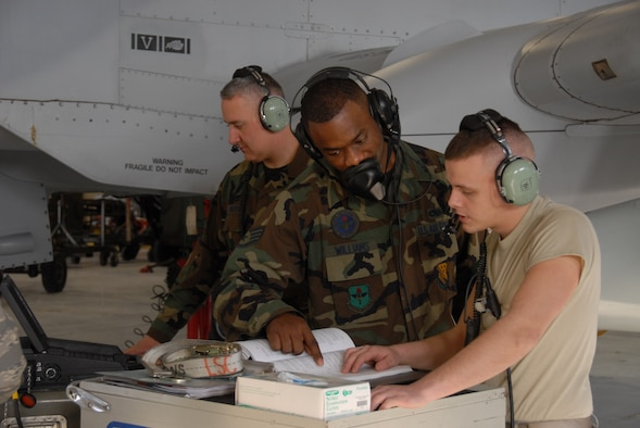 SRA Jeremy Wesley and TSgt. Jon Huerta from the 127th Aircraft Maintenance Squadron weapons section, train with SSgt. Brent Williams (center), an active duty instructor with U.S. Air Force from  Det 13, Nellis Air Base. The group is working with the PAX Interface 1760 which double checks the wiring between the A-10 aircraft and the weapons pylon.