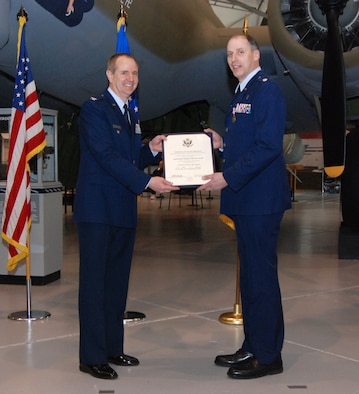 DOVER AIR FORCE BASE, Del. -- Former 512th Airlift Wing Vice Commander Col. David Wuest presents Chaplain (Lt. Col.) John Groth with his retirement certificate during a ceremony Feb. 7 at the Air Mobility Command Museum here. The Air Force Reserve chaplain held a farewell dinner at the AMC Museum Feb.6. During both events, colleagues of the Air Force Reserve chaplain shared memories and stories about his ministry and time spent in the Reserve. (U.S. Air Force photo/Staff Sgt. Steve Lewis)