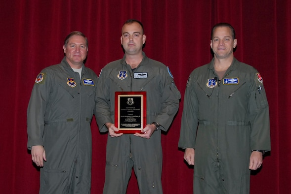 Lt. Col. Ed Vaughan (center) is inducted into the Air Force Safety Hall of Fame in a ceremony Feb. 6.  With him are (left) Maj. Gen. Maury Forsyth, commander of the Spaatz Center at Maxwell Air Force Base, Ala., and Col. Marcus Quint, chief of the Air National Guard Safety Directorate. (Air Force photo by Jamie Pitcher)