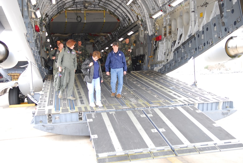 Col. (Dr.) Connie McNabb, Col. (Dr.) Connie McNabb, Texas Military Forces State Joint Surgeon; Evelyn Delgado, Department of State Health Services (DSHS) assistant commissioner for Family Community Health Services; and Dr. David Lakey, DSHS commissioner, deplane after an orientation flight in a C-17 aircraft at Lackland Air Force Base, Texas, Feb. 7. (TXMF photo by Tech. Sgt. Rene Castillo)