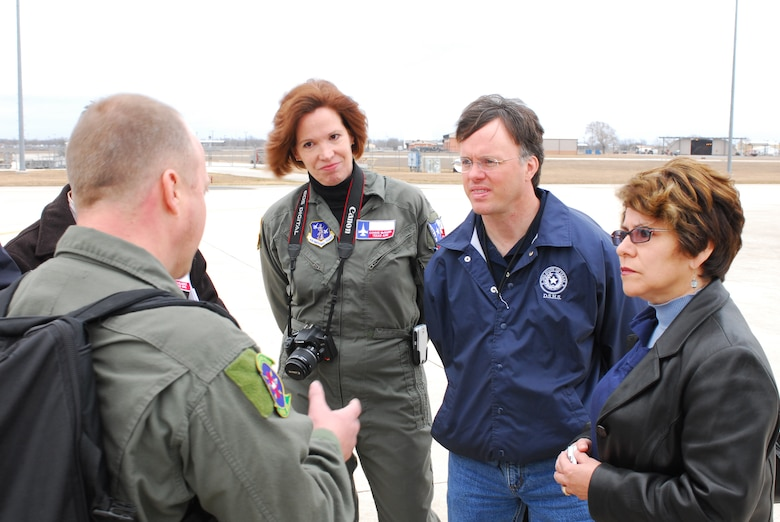 Col. (Dr.) Connie McNabb, Texas Military Forces State Joint Surgeon; Dr. David Lakey, commissioner of the Department of State Health Services (DSHS); and Evelyn Delgado, DSHS assistant commissioner for Family Community Health Services, listen to Chief Master Sgt. Rodney Christa, 433rd Aerospace Evacuation Squadron superintendent, brief them prior to boarding a C-17 aircraft. Colonel McNabb and the DSHS guests visited Lackland Air Force Base Feb. 7 to learn about the C-17 and its medical evacuation capabilities. (TXMF photo by Tech. Sgt. Rene Castillo)