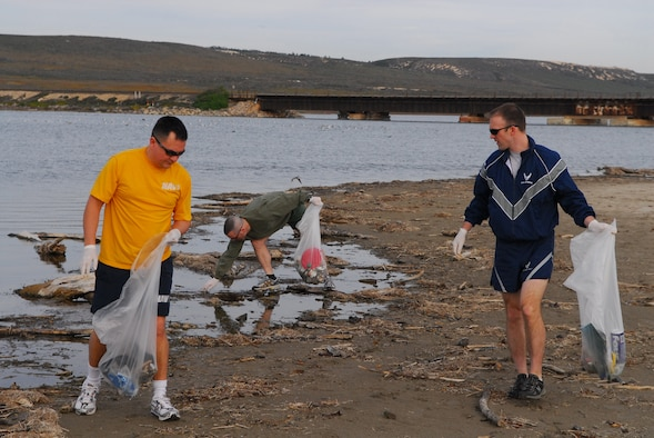 VANDENBERG AIR FORCE BASE, Calif. – Maj. Joe Iungerman, Navy Cmdr. Stephen Higuera and Marine Maj. Brian Anderson, from the Joint Functional Component Command for Space,cleanup trash Feb. 5 along Surf Beach. (U.S. Air Force photo/Airman 1st Class Steve Bauer)