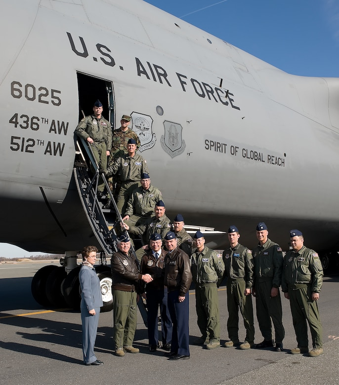 The Spirit of Global Reach, Team Dover's first C-5M Super Galaxy, was delivered Feb. 9.  (Front, from right) Col. Manson Morris, 436th Airlift Wing commander, and Col. Randal Bright, 512th AW commander, greet Gen. Arthur Lichte, Air Mobility Command commander and the delivery official for the C-5M, and Lorraine Martin, Lockheed Martin C-5 program vice president, while the delivery crew poses in the background.  (U.S. Air Force photo/Jason Minto)