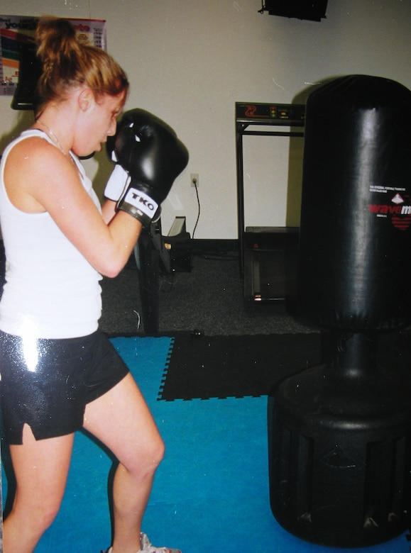 Staff Sgt. Kelly Corrow, aerospace control and warning systems specialist, 103rd Air Operations Group, works out at her gym during her off-duty hours.  Boxing is just one of the extreme sports Corrow enjoys in her free time.  (Photo courtesy of Staff Sgt. Kelly Corrow)