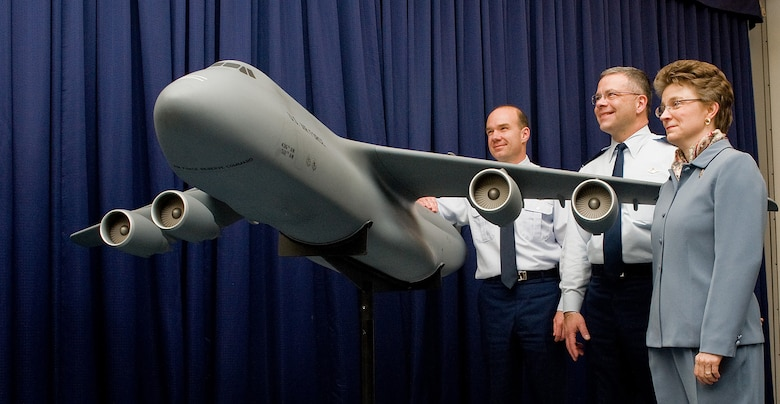 (Left to right) Col. Manson Morris, 436th Airlift Wing commander, Col. Randal Bright, 512th Airlift Wing commander, and Lorraine Martin, Lockheed Martin vice president, stand with a small model of the C-5M Super Galaxy Feb. 9 at The Landings Club. Ms. Martin presented the model to Team Dover following the delivery ceremony. (U.S. Air Force photo/ Tom Randle)