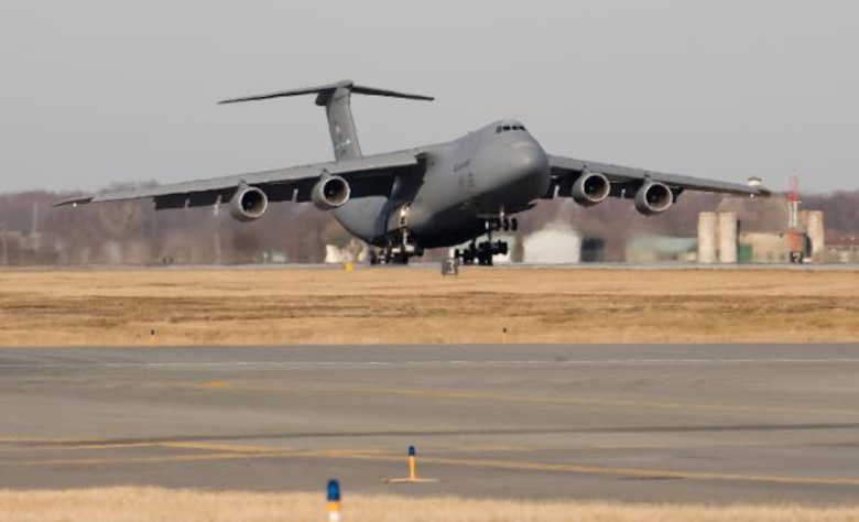 Team Dover's first C-5M Super Galaxy, the Spirit of Global Reach, lands at Dover Feb. 9.  Gen. Arthur Lichte, Air Mobility Command commander, was the delivery official.  (U.S. Air Force photo/Jason Minto)