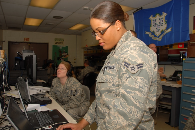 Airman 1st Class Desiree Patterson, aerospace control and warning systems apprentice, 103d Air Operations Group, establishes connectivity to a live video feed of the Presidential Inauguration, Jan. 20, 2009.  The Connecticut National Guard deployed 12 personnel to Andrews Air Force Base where they supplied a full spectrum of communication services to Joint Task Force District of Columbia.  (U.S. Air Force Photo by Staff Sgt. Erin McNamara)