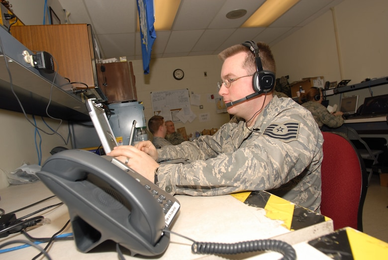Tech. Sgt. Brett Mazur, logistics specialist with the 103rd Air Operations Group, Connecticut Air National Guard, uses Radio Interoperability Software to monitor communications traffic Tuesday Jan. 20, 2009, in support of Joint Task Force District of Columbia and the Presidential Inauguration, while deployed to Andrews Air Force Base, MD.   (U.S. Air Force Photo by Staff Sgt. Erin McNamara)