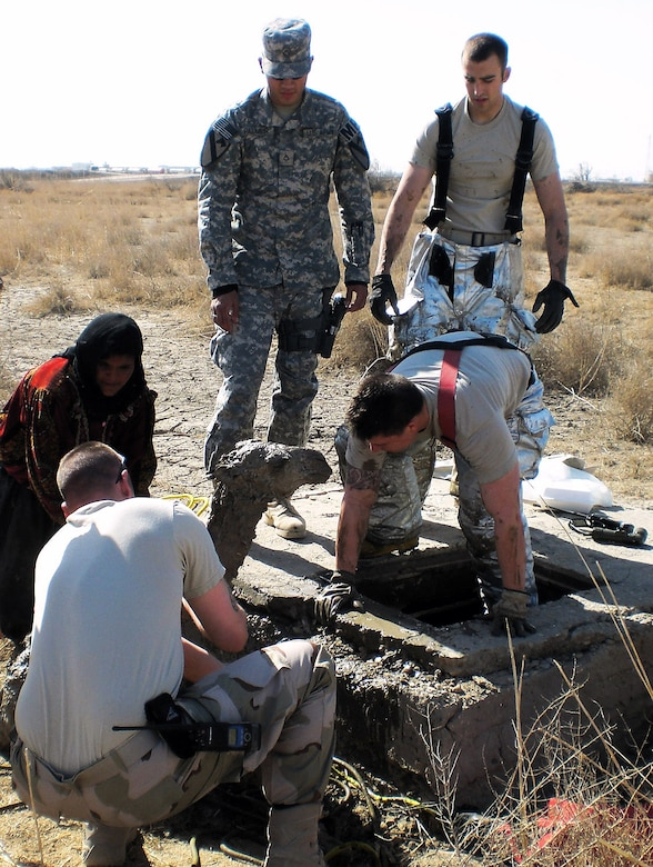 Firefighters rescue a baby camel trapped in a manhole near Ali Base, Iraq, Feb. 9. The firefighters are with the 407th Expeditionary Civil Engineer Squadron. (U.S. Air Force photo/Staff Sgt. Kenya Shiloh)