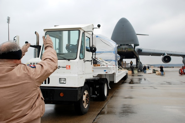 167th Airlift Wing Loadmaster, MSgt Douglas Stroz, directs the loading of an Ares 1-X test crew module and launch abort system onto a C-5 aircraft at Langley Air Force Base, Va, on January 27, 2009. The crew delivered the cargo to the Kennedy Space Center in Florida the following day. The ARES 1-X test crew module and launch abort system is part of a complex flight test program which will eventually lead to the launch of the Orion spacecraft in early 2013.