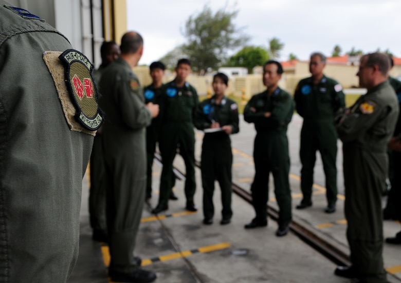 """ANDERSEN AIR FORCE BASE, Guam - Lt. Col. Orlando """"Slider"""" Sanchez, 90th Expeditionary Fighter Squadron pilot, briefs Lt. Gen. Edward Rice, United States Forces Japan commander, Maj. Gen. Hideo Wakabayashi, Japan Air Self Defense Force 3rd Air Wing commander, Brig. Gen. Phil Ruhlman, 36th Wing commander, and other JASDF members on the F-22A Raptor during a tour here Feb. 13. The 90th Expeditionary Fighter Squadron is deployed to Andersen from Eielson AFB, Alaska, as a part of the Theater Security Package. The F-22 Raptor is the Air Force's newest fighter aircraft. Its combination of stealth, supercruise, maneuverability, and integrated avionics, coupled with improved supportability, represents an exponential leap in warfighting capabilities.(U.S. Air Force photo by Airman 1st Class Courtney Witt)"""