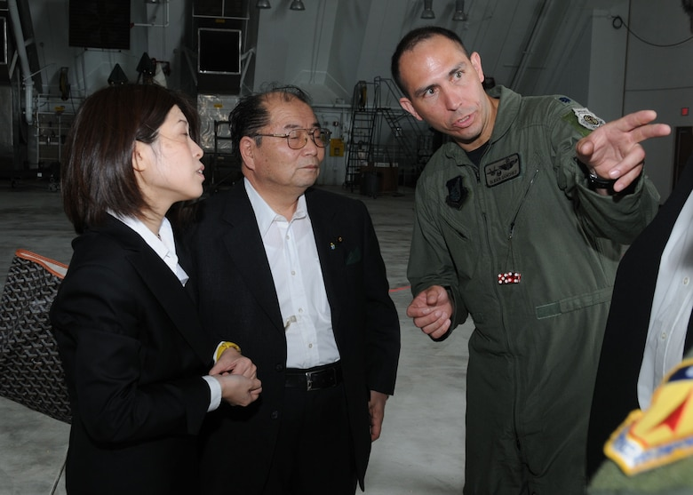 """ANDERSEN AIR FORCE BASE, Guam - Lt. Col. Orlando """"Slider"""" Sanchez, 90th Expeditionary Fighter Squadron F-22 Raptor pilot, explains the F-22A Raptor's capabilities to Seigo Kitamura, Senior Vice Minister of Defense for the Prime Minister of Japan, during a site visit here Feb. 14. During his tour, Mr. Kitamura received a mission briefing about the 36th Wing and the annual Cope North exercise. Cope North 09-1 is a Pacific Command-sponsored exercise designed and developed by 13th Air Force, Detachment 1, to increase combat readiness and interoperability between the U.S. Air Force, Navy, and the Japan Air Self Defense Force in defense of Japan. (U.S. Air Force photo by Senior Airman Nichelle Griffiths)"""