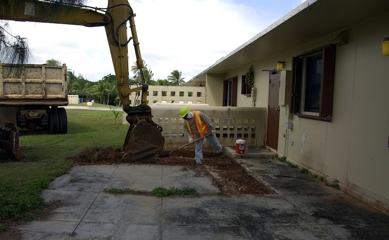 ANDERSEN AIR FORCE BASE, Guam -- Larry Cabantting, a Guam Construction Company contractor, helps an associate level a patio Feb. 17 here. Nearly 400 patios are being replaced in base housing, totalling about $1 million in repairs. (U.S. Air Force photo by Airman 1st Class Carissa Wolff)