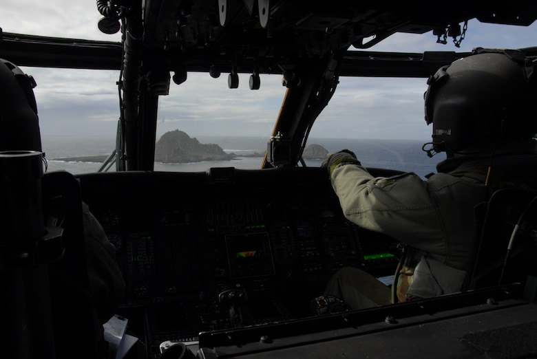 Aircrews from the 129th Rescue Wing, Moffett Federal Airfield, approach Farallon Island off the coast of San Francisco. The unit supported the U.S. Fish and Wildlife Service by transporting 48 new photovoltaic batteries to power a lighthouse and workshop at the Fish and Wildlife Service research facility in the Farallon National Wildlife Refuge Feb. 17. (U.S. Air Force photo by Tech Sgt. Ray Aquino)(RELEASED)