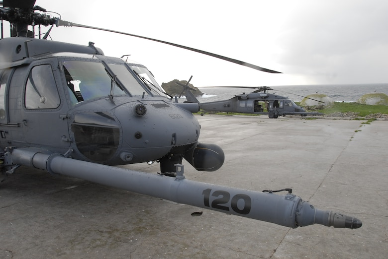 Two HH-60G Pave Hawks from the 129th Rescue Wing, Moffett Federal Airfield, sit on a helipad at Farallon Island during a battery transport mission. The unit supported the U.S. Fish and Wildlife Service by transporting 48 new photovoltaic batteries to power a lighthouse and workshop at the Fish and Wildlife Service research facility in the Farallon National Wildlife Refuge Feb. 17. (U.S. Air Force photo by Tech Sgt. Ray Aquino)(RELEASED)