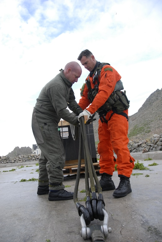 Tech Sgt. Christopher Gabor and Chief Master Sgt. Richard Nowaski, HH-60G Pave Hawk flight engineers from the 129th Rescue Wing at Moffett Federal Airfield, prepare batteries for transport on Farallon Island. The unit supported the U.S. Fish and Wildlife Service by transporting 48 new photovoltaic batteries to power a lighthouse and workshop at the Fish and Wildlife Service research facility in the Farallon National Wildlife Refuge Feb. 17. (U.S. Air Force photo by Tech Sgt. Ray Aquino)(RELEASED)