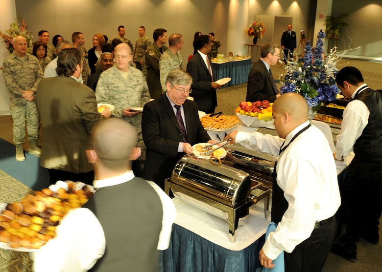 Mr. John Wagner (center, with plate), Launch and Range Systems Wing chief technical director, is served by a staff member of the Club during the 2009 National Prayer Breakfast held at the Gordon Conference Center, Los Angeles AFB, Feb. 11. Mr. Wagner was one of the honored guests. (Photo by Stephen Schester)