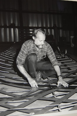 Mr. Godwin works on the Wright Flyer project in his Brundidge workshop in 1985. The Maxwell Wright Flyer was the first of four such exhibits he has built. (Courtesy photo)