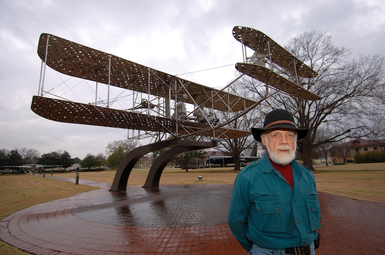 Larry Godwin, of Brundidge, Ala., stands before the Wright Flyer monument he designed and built 24 years ago for Maxwell's Air Park. Mr. Godwin recently revisited his work while in Montgomery on business. (Air Force photo by Donna Burnett)