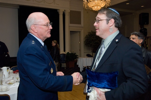 Chap. (Maj. Gen.) Cecil Richardson greets Senior Master Sgt. (ret.) Dave Berry at the Maxwell-Gunter National Prayer Breakfast Feb. 13 at the Maxwell Officers' Club. Chaplain Richardson, chief of Chaplains for the Air Force, was the keynote speaker.  Sergeant Berry is a local Jewish lay leader. (Air Force photo by Melanie Rodgers Cox)