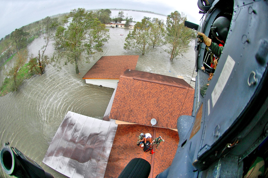 NEDERLAND, Texas -- Pararescuemen from the 920th Rescue Wing saved 17 people from floodwaters in the aftermath of Hurricane Ike. With his family safely on one of the wing's HH-60G Pave Hawk rescue helicopters, a homeowner gathers the last of his belongings before being hoisted up. (U.S. Air Force photo/Tech. Sgt. Paul Flipse)