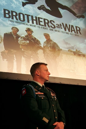 Army Capt. Isaac Rademacher stands in front of the screen after the premiere of 'Brothers at War' Feb. 20 at the National Press Club. Isaac has been deployed four times and spent three years in a combat zone. His brother Jake was motivated to make the documentary because he felt a growing gap between himself and his brothers.