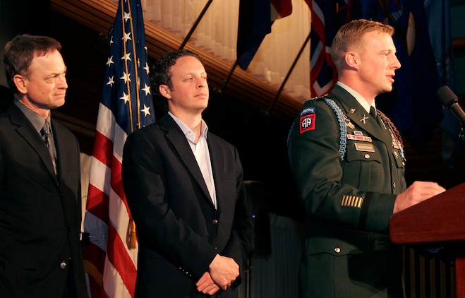 Army Capt. Isaac Rademacher answers a question while his brother Jake Rademacher and actor Gay Sinise look on after the premiere of 'Brothers at War' Feb. 20 at the National Press Club. Jake made the documentary while he was embedded with four different combat units in Iraq.