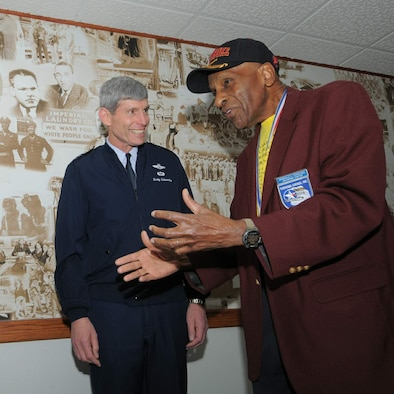Air Force Chief of Staff Gen. Norton Schwartz visits with Dr. Granville Coggs Feb. 19 in front of the Tuskegee Airmen mural in the main corridor of the 99th Flying Training Squadron at Randolph Air Force Base, Texas. Dr. Coggs is a Tuskegee Airman who trained at Tuskegee Institute in the 1940s. The 99th FTS traces its roots back to the 99th Fighter Squadron, which was the first all-black unit in the Army Air Corps when it activated in May 1942. (U.S. Air Force photo/Melissa Peterson)
