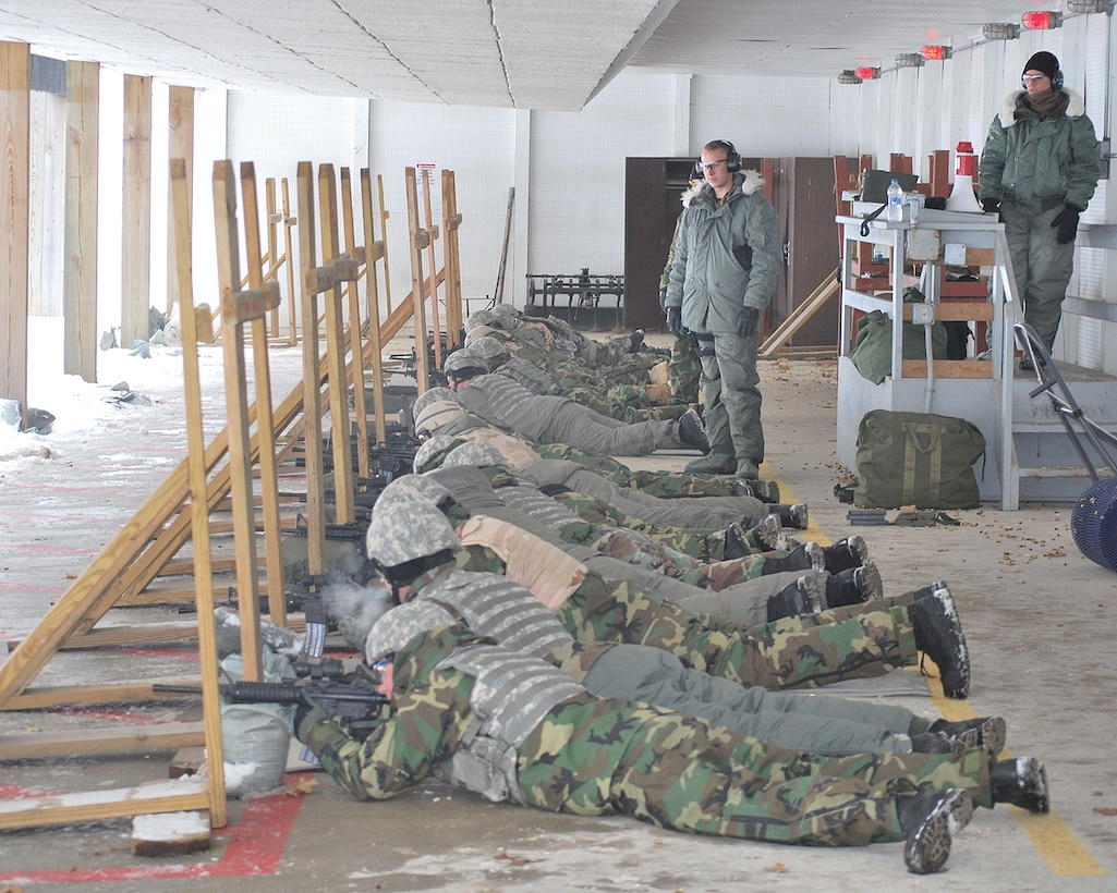 Members of the 114th Security Forces Squadron bundled up to qualify on the M-16 during annual training at Volk Field, Wis. Jan. 9th. Tech. Sgts. Gretchen Hansen and Jeremy Wajer oversee the activities.