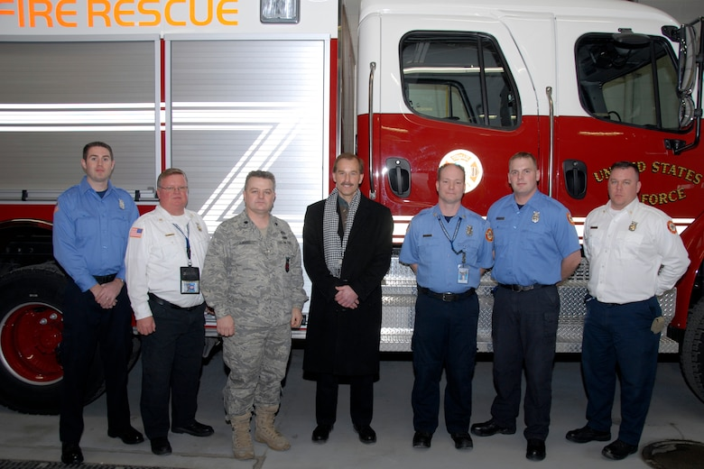 Jeff Skiles, co-pilot of the U.S. Airways Flight 1549 that manuevered a water landing on the Hudson River in New York in January, poses with members of the Truax Field Fire Station Feb. 20. Mr. Skiles, a native of Oregon, Wis., was invited to tour the Dan County Regional Airport and fielded questions on the water landing itself, rescue efforts and even his appearance on the David Letterman Show.  (U.S. Air Force Photo by Staff Sgt. Jon LaDue)