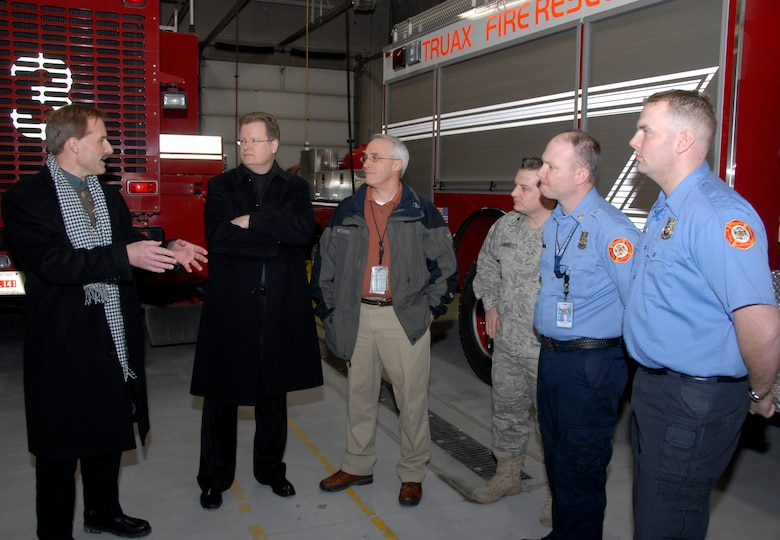 Jeff Skiles, co-pilot of the U.S. Airways Flight 1549 that manuevered a water landing on the Hudson River in New York in January, visits with members of the Dane County Regional Airport and Truax Field Fire Station Feb. 20. Mr. Skiles, a native of Oregon, Wis., was invited to tour the airport and fielded questions on the water landing itself, resuce efforts and even his appearance on the David Letterman Show.  (U.S. Air Force Photo by Staff Sgt. Jon LaDue)