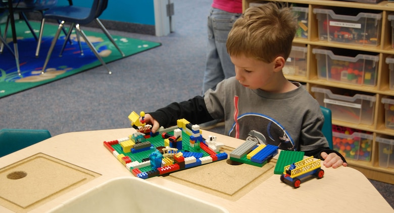Little Warrior Riley, 6, plays with Legos at the Youth Center Feb. 5. He is one of several children enrolled in the before and after school program there. (U.S. Air Force photo/Valerie Mullett)