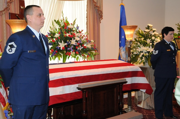 NIAGARA FALLS AIR RESERVE STATION, N.Y. - Senior Master Sgt. Ryan King (left) and Tech. Sgt. Pam Rickard (right), from the 30th Aerial Port Squadron stand as honor guards beside the casket of Chief Master Sgt. (retired) John Fiore of the 914th Airlift Wing, U.S. Air Force Reserve.  Chief Fiore was tragically killed in the crash of Continental Airlines Flight 3407 on February 12, 2009.  A tremendous amount of support for the family of Chief Fiore was evident during the memorial service by both military and the civilian populace.  (U.S. Air Force photo by Master Sgt. Peter Borys)