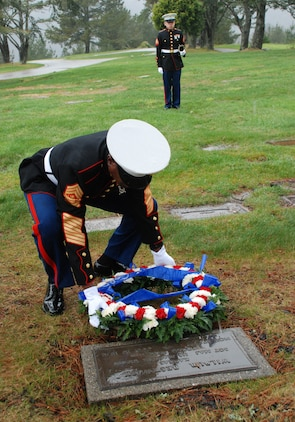 Sgt. Maj. Carlton W. Kent, 16th Sergeant Major of the Marine Corps, places a wreath at the gravesite of the first Sergeant Major of the Marine Corps, Sgt. Maj. Wilbur Bestwick, at Skylawn Memorial Park Feb. 22. The burial site for Bestwick is incorrectly listed on his biography, and the Inspector-Instructor staff at nearby San Jose, Calif., were able to track down the correct site. Kent paid his respects during a recent visit to I&I San Jose.