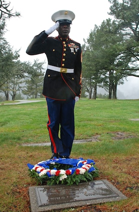 Sgt. Maj. Carlton W. Kent, 16th Sergeant Major of the Marine Corps, salutes after laying a wreath at the gravesite of the first Sergeant Major of the Marine Corps, Sgt. Maj. Wilbur Bestwick, at Skylawn Memorial Park Feb. 22. The burial site for Bestwick is incorrectly listed on his biography, and the Inspector-Instructor staff at nearby San Jose, Calif., were able to track down the correct site. Kent paid his respects during a recent visit to I&I San Jose.