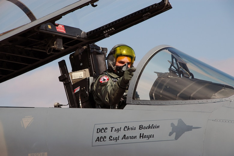 Col. Robert Leeker, 131st Wing Commander points at the crowd prior to taking his final flight from Lambert International in a F-15, Feb. 21, 2009. Photo by MSgt. Mary-Dale Amison