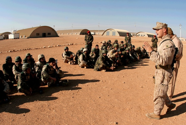 On a sunny Sunday morning at H3 Airfield in Iraq's western Al Anbar province, Staff Sgt. Timothy Wenrich, the 3rd Platoon sergeant for Company E, 2nd Battalion, 25th Marine Regiment, teaches Iraqi soldiers from the 3rd Battalion, 29th Brigade, 7th Iraqi Army Division infantry fire and movement techniques, Feb. 23, 2009.  The mission was Company E's last here, as the unit prepares to retrograde to Al Asad Air Base, a large transportation hub, next month before redeploying back to the States.  Wenrich, 30, served on active duty for four years before joining the Marine Forces Reserve in 2005.