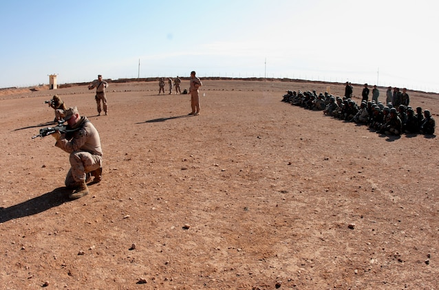 Reserve Marines from Company E, 2nd Battalion, 25th Marine Regiment, Regimental Combat Team-8, demonstrate infantry fire and movement techniques to soldiers from the 3rd Battalion, 29th Brigade, 7th Iraqi Army Division at H3 Airfield Feb. 23, 2009.  Company E is finishing up a 7-month tour in Iraq and is scheduled to return to their home training center in Harrisburg, Pa. in April.