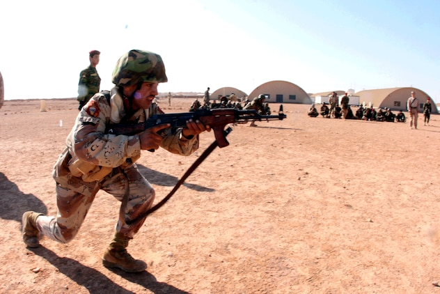An Iraqi Army soldier from 3rd Battalion, 29th Brigade, 7th Iraqi Army Division rushes a notional enemy during a training exercise at H3 Airfield in Iraq's western Al Anbar Province Feb. 23, 2009.  The Reserve Marines of Company E, 2nd Battalion, 25th Marine Regiment, Regimental Combat Team-8 spent the morning honing the Iraqi soldiers infantry skills.