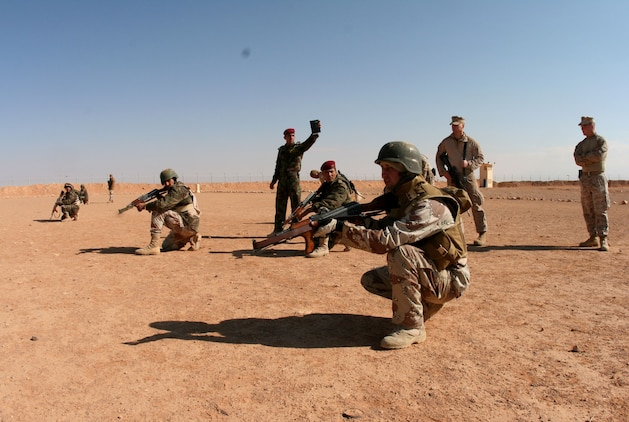 Under the tutelage of Reserve Marines from Company E, 2nd Battalion, 25th Marine Regiment, Regimental Combat Team-8, a squad of Iraqi Army soldiers from 3rd Battalion, 29th Brigade, 7th Iraqi Army Division perform fire and movement techniques at H3 Airfield in a remote location in western Al Anbar desert Feb. 23.