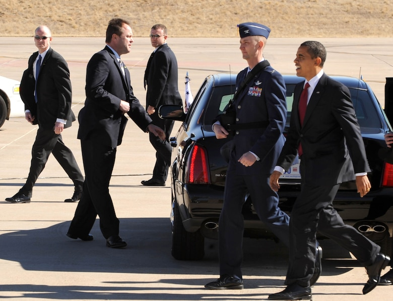 BUCKLEY AIR FORCE BASE, Colo. -- President Barack Obama walks with Col. Wayne McGee, 460th Space Wing Commander, to meet a handful of troops from Team Buckley. President Obama was in Denver to sign into law a new economic stimulus plan designed to create millions of jobs and boost consumer spending. (U.S. Air Force photo by Senior Airman Christopher Bush)