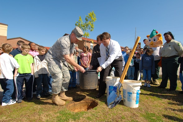 Col. Kris Beasley, 42nd Air Base Wing commander, and Brian Perry, Maxwell Elementary School assistant principal, plant a tree commemorating Arbor Day at the school Feb. 19. (Air Force photo by Jamie Pitcher)
