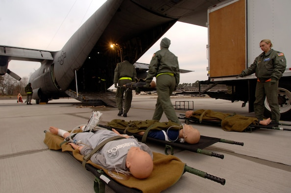 Flight nurses and medical technicians load 1,500 pounds of medical equipment and training mannequins into a C-130 at Ramstein Air Base shortly before takeoff on a weekly recurring training sortie for personnel assigned to the 86th Aeromedical Evacuation Squadron. The flight-qualified healthcare providers fly with the 37th Airlift Squadron to remain proficient in their skills.  (Department of Defense photo by Master Sgt. Scott Wagers)