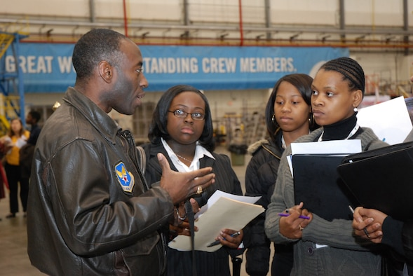 """ATLANTA, Ga. - Lt. Col. Gil Williams, 94th Airlift Wing Command Post commander, provides insight to students on making a career decision in aviation at the Hartsfield-Jackson Atlanta International Airport's """"One Great Day of Job Shadowing"""" event Feb. 27.  The event was hosted by the airport for more than 300 metro Atlanta junior high and high school students interested in careers in aviation.  Career representatives from the Atlanta area included pilots--Air Force Reserve and commercial; the Federal Aviation Administration, and airport representatives in mechanical engineering and airport concessions.  (U.S. Air Force photo/Master Sgt. Stan Coleman)"""