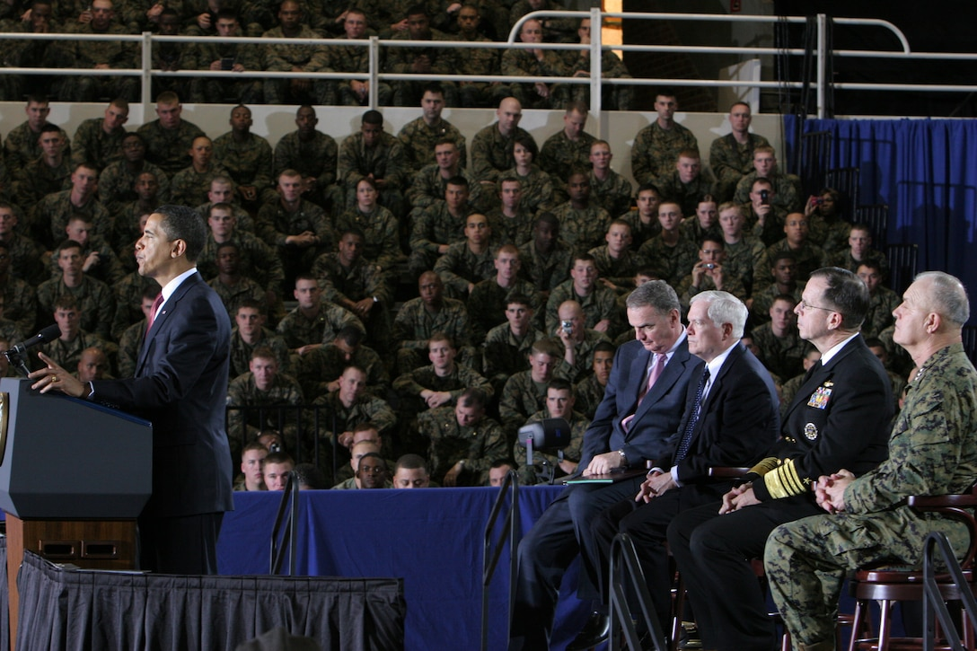 President Barack Obama speaks to Marines and sailors aboard Camp Lejeune, N.C., Feb. 27, 2009. On the stage behind him are, from right to left, the commanding officer of II Marine Expeditionary Force, Lt. Gen. Dennis J. Hejlik; Chairman Joint Chiefs of Staff, Adm. Mike Mullen; Secretary of Defense, Robert M. Gates; and National Security Advisor and former Commandant of the Marine Corps, Gen. James L. Jones.  (Official Marine Corps photo by Cpl. Alicia R. Johnson)